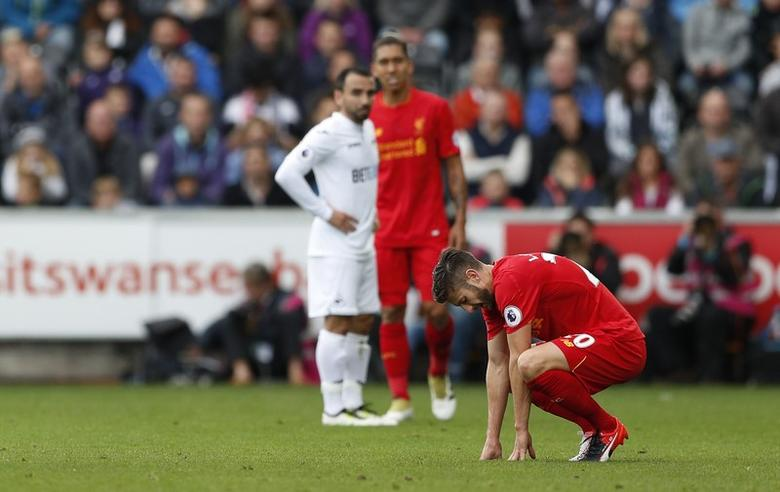 Britain Soccer Football - Swansea City v Liverpool - Premier League - Liberty Stadium - 1/10/16Liverpool's Adam Lallana goes down injuredAction Images via Reuters / John SibleyLivepicEDITORIAL USE ONLY.