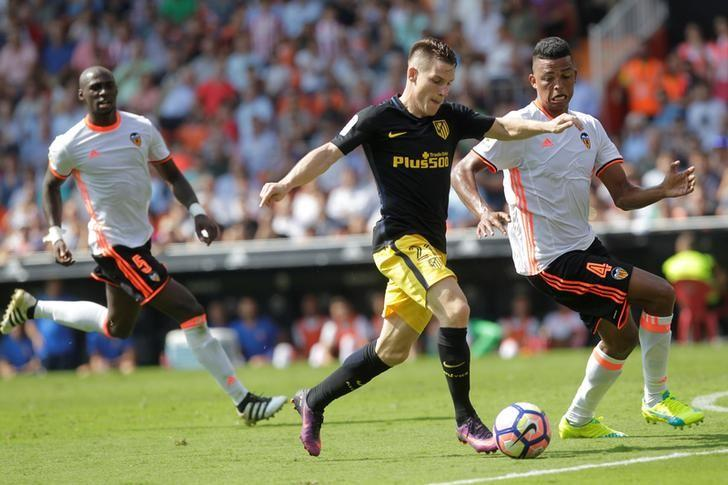 Football Soccer - Spanish Liga - Valencia v Atletico Madrid - Mestalla Stadium - Valencia, Spain - 2/10/16.  Atletico Madrid's Kevin Gameiro and Valencia's Aderlan Santos in action. REUTERS/Heino Kalis