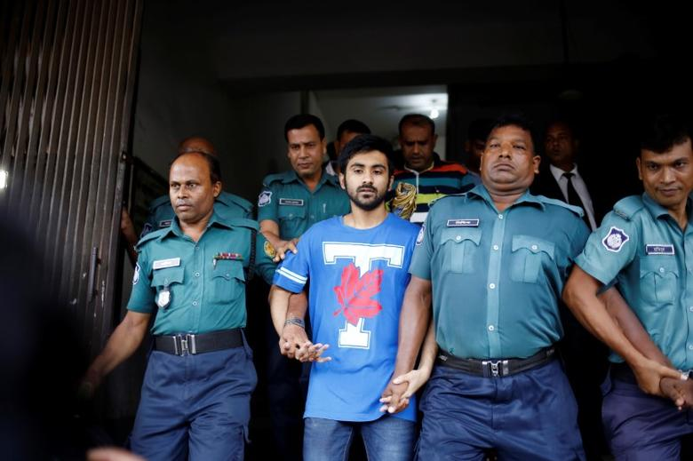 Tahmid Hasib Khan, a student at Toronto University and one of the suspects of recent Gulshan attack is seen leaving the court in Dhaka, Bangladesh, August 13, 2016. REUTERS/Mohammad Ponir Hossain/Files