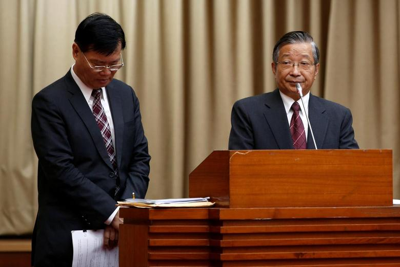 Financial Supervisory Commission (FSC) chairman Ding Kung-Wha (L) and Mega Financial's chairman Michael Chang attend a parliamentary session at Legislative Yuan in Taipei, Taiwan September 21, 2016. REUTERS/Tyrone Siu