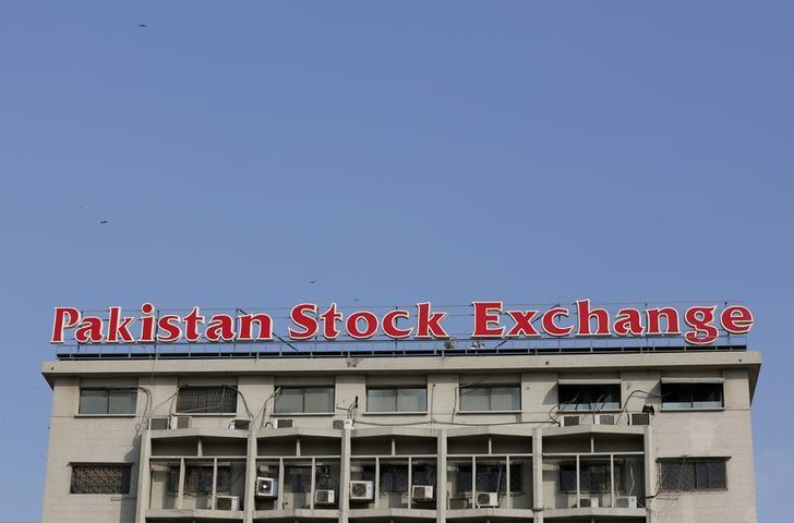 A sign of the Pakistan Stock Exchange is seen on its building in Karachi, Pakistan January 11, 2016. REUTERS/Akhtar Soomro/File Photo