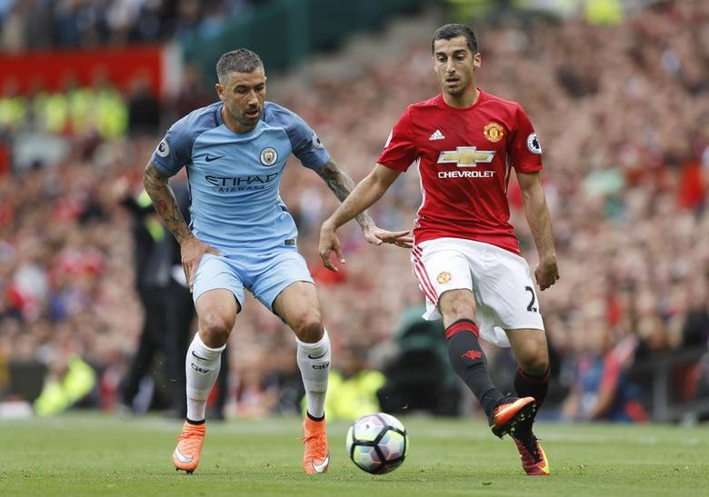 Manchester City's Aleksandar Kolarov in action with Manchester United's Henrikh Mkhitaryan. Manchester United v Manchester City - Premier League - Old Trafford - 10/9/16. Action Images via Reuters / Carl Recine Livepic