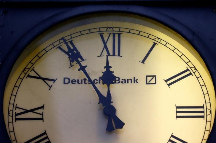 A vintage clock with the logo of Deutsche Bank is pictured outside the bank's branch in Wiesbaden, Germany, January 28, 2015.  REUTERS/Kai Pfaffenbach/Files