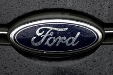 The Ford logo is pictured at the Ford Motor Co plant in Genk,Belgium December 17, 2014. REUTERS/Francois Lenoir/File Photo