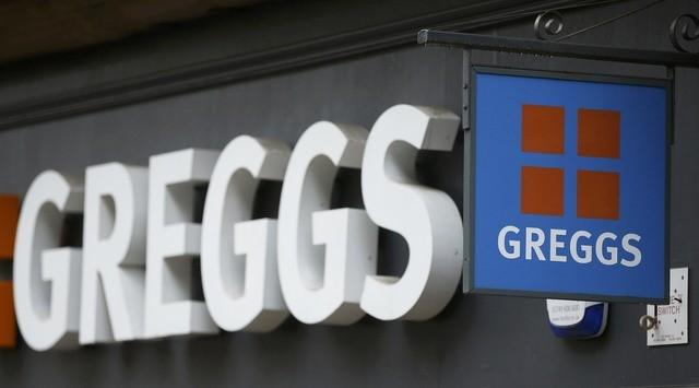 A sign hangs outside a Greggs bakery in Bradford, Britain March 1, 2016. REUTERS/Phil Noble/File Photo