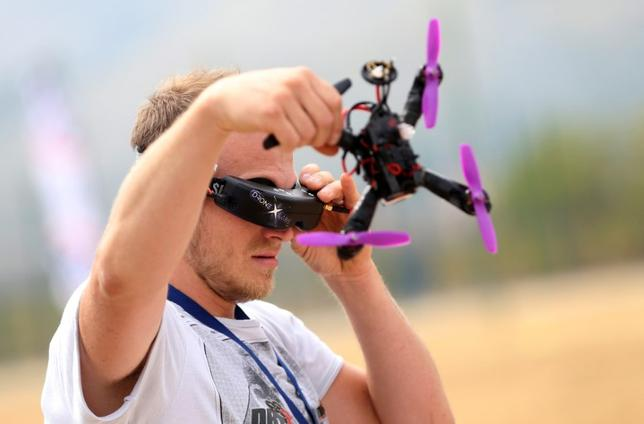 A drone pilot prepares his drone before the first SPARK Multirotor Challenge in Mostar, Bosnia and Herzegovina September 10, 2016. REUTERS/Dado Ruvic/File Photo