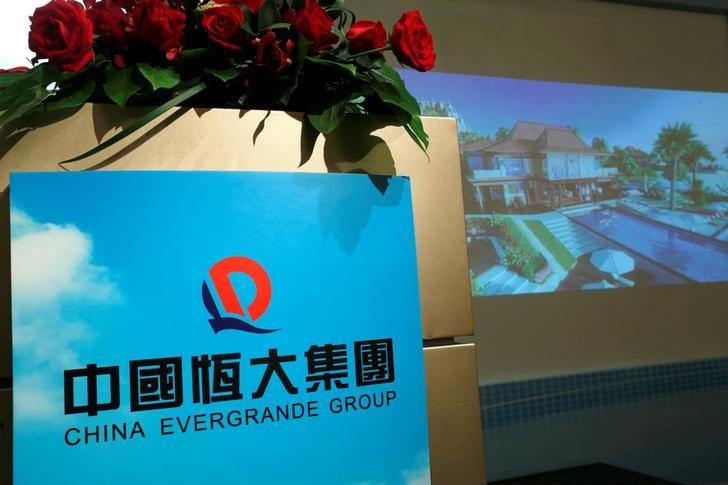 Promotional footage on a property development of China Evergrande Group is shown at a news conference on the company's interim results in Hong Kong, China August 30, 2016.  REUTERS/Bobby Yip/Files