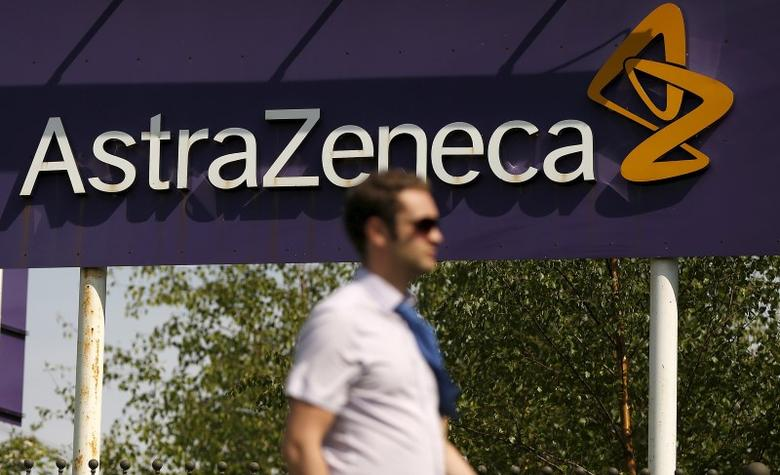 A man walks past a sign at an AstraZeneca site in Macclesfield, central England May 19, 2014. REUTERS/Phil Noble/File Photo