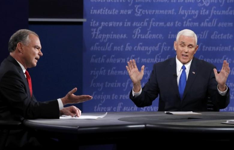 Democratic U.S. vice presidential nominee Senator Tim Kaine (L) and Republican U.S. vice presidential nominee Governor Mike Pence discuss an issue during their vice presidential debate at Longwood University in Farmville, Virginia, U.S., October 4, 2016.       REUTERS/Jonathan Ernst