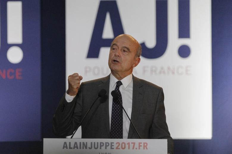 French politician Alain Juppe, current mayor of Bordeaux, a member of the conservative Les Republicains political party and candidate for their presidential primary, attends a rally as he campaigns in Lyon, France, September 29, 2016.    REUTERS/Emmanuel Foudrot/Files