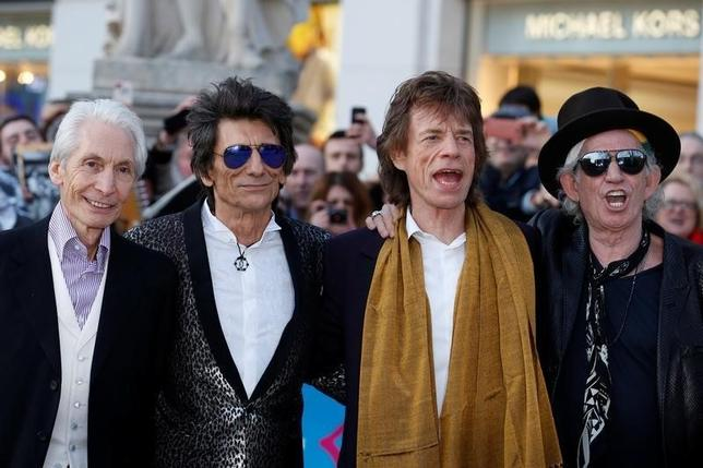 Members of the Rolling Stones (L-R) Charlie Watts, Ronnie Wood, Mick Jagger and Keith Richards arrive for the ''Exhibitionism'' opening night gala at the Saatchi Gallery in London, Britain April 4, 2016. REUTERS/Luke MacGregor/File Photo