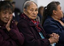 Elders Irene Tetso and Veronica Bayha watch men play handgames at the community hall in in Deline, Northwest Territories, Canada August 31, 2016. REUTERS/Pat Kane