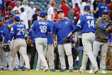 October 6, 2016; Arlington, TX, USA; Toronto Blue Jays manager John Gibbons (5) and the Blue Jays celebrate the 10-1 victory against the Texas Rangers following game one of the 2016 ALDS playoff baseball game at Globe Life Park in Arlington. Mandatory Credit: Tim Heitman-USA TODAY Sports