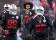 San Francisco 49ers quarterback Colin Kaepernick (7) runs onto the field during a NFL game against the Arizona Cardinals at Levi's Stadium. Mandatory Credit: Kirby Lee-USA TODAY Sports