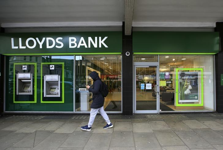 A man walks past a Lloyds Bank branch in central London, Britain February 25, 2016. REUTERS/Paul Hackett/Files