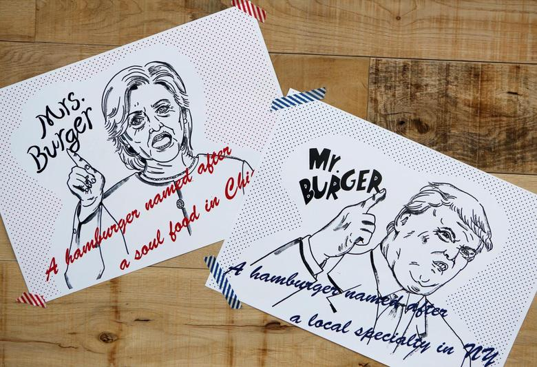 Campaign posters of Mr. and Mrs. Burger featuring U.S. presidential candidates Hillary Clinton and Donald Trump are displayed at J.S. Burgers Cafe in Tokyo, Japan October 7, 2016. REUTERS/Megumi Lim