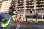 LaPlaya Resort & Suites owner Efrain Silva (L) and Don Rasmussen survey the damage to Silva's hotel after the eye of Hurricane Matthew passed Daytona Beach, Florida, U.S. October 7, 2016.  REUTERS/Phelan Ebenhack