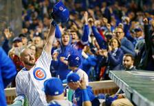 Oct 8, 2016; Chicago, IL, USA; Chicago Cubs relief pitcher Travis Wood (37) acknowledges fans with a curtain call after hitting a home run against the San Francisco Giants during the fourth inning during game two of the 2016 NLDS playoff baseball series at Wrigley Field. Mandatory Credit: Jerry Lai-USA TODAY Sports