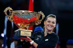 Tennis - China Open women's final - Beijing, China - 09/10/16. Poland's Agnieszka Radwanska holds the trophy after defeating Britain's Johanna Konta.  REUTERS/Thomas Peter