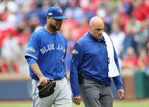 Oct 7, 2016; Arlington, TX, USA; Toronto Blue Jays starting pitcher Francisco Liriano (45) is checked on by the trainer and would come out of the game after being hit by a batted ball during the eighth inning of game two of the 2016 ALDS playoff baseball series against the Texas Rangers at Globe Life Park in Arlington. Mandatory Credit: Kevin Jairaj-USA TODAY Sports