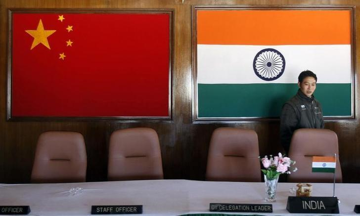 A man walks inside a conference room used for meetings between military commanders of China and India, at the Indian side of the Indo-China border at Bumla, in Arunachal Pradesh, November 11, 2009. REUTERS/Adnan Abidi/File Photo
