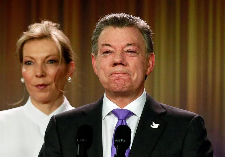 Colombia's President Juan Manuel Santos reacts as he addresses the media next to his wife and first lady Maria Clemencia de Santos, after winning the Nobel Peace Prize, at Narino Palace in Bogota, Colombia, October 7, 2016. REUTERS/John Vizcaino