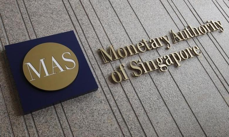 The logo of the Monetary Authority of Singapore (MAS) is pictured at its building in Singapore in this February 21, 2013 file photo.  REUTERS/Edgar Su/Files