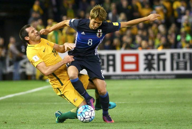 Football Soccer - Australia v Japan - World Cup 2018 Qualifier - Docklands stadium - Melbourne, Australia - 11/10/16.  Genki Haraguchi of Japan in action with Ryan McGowan of Australia. REUTERS/David Gray