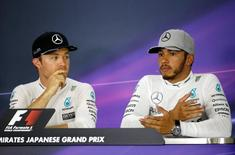Formula One - Japanese Grand Prix - Suzuka Circuit, Japan- 9/10/16.  Mercedes' drivers Nico Rosberg of Germany and Lewis Hamilton of Britain attend a news conference after the race. REUTERS/Toru Hanai