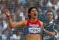 Russia's Tatyana Lysenko reacts during the women's hammer throw final in the London 2012 Olympic Games at the Olympic Stadium August 10, 2012.                  REUTERS/Kai Pfaffenbach