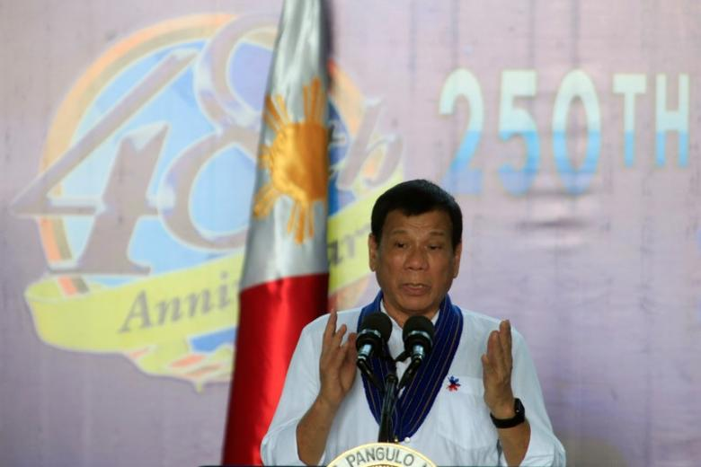 President Rodrigo Duterte gestures while delivering a speech during the 250th Presidential Airlift Wing (PAW) anniversary at the villamor air base in Pasay city, metro Manila, Philippines September 13, 2016.           REUTERS/Romeo Ranoco