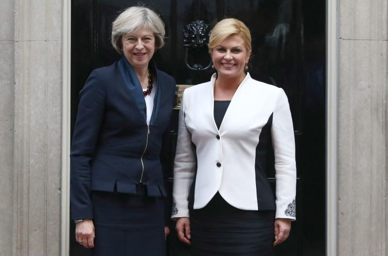 Britain's Prime Minister Theresa May (L)  greets Croatia's President Kolinda Grabar-Kitarovic at Downing Street in London, Britain October 11, 2016. REUTERS/Neil Hall