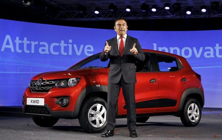 Carlos Ghosn, CEO of the Renault-Nissan Alliance, speaks to the media as he stands next to Renault's new Kwid car during its launch in Chennai, India, May 20, 2015.   REUTERS/Stringer/Files