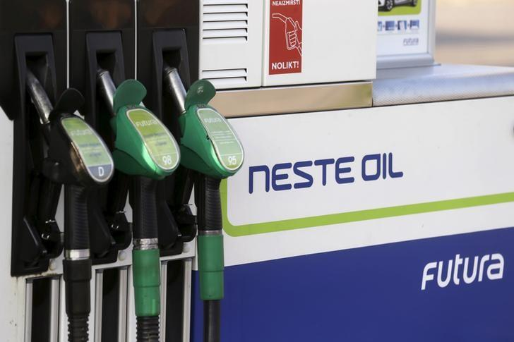 Fuel pumps are pictured at a Neste Oil gas station in Adazi, Latvia August 5, 2014. REUTERS/Ints Kalnins/File Photo