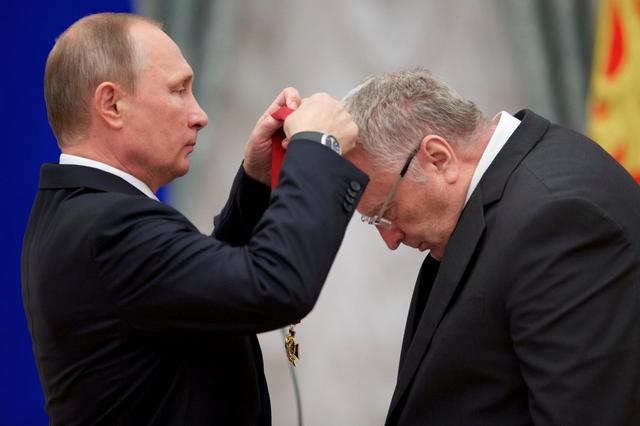 Russian President Vladimir Putin (L) awards head of the Liberal Democratic Party of Russia (LDPR) Vladimir Zhirinovsky during a ceremony at the Kremlin in Moscow, Russia, September 22, 2016. REUTERS/Ivan Sekretarev/Pool