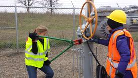 Activists are seen attempting to cut chains after trespassing into a valve station for pipelines carrying crude from Canadian oils sands into the U.S. markets near Clearbrook, Minnesota, U.S., in this image released on October 11, 2016.   Courtesy Climate Direct Action/Handout via REUTERS