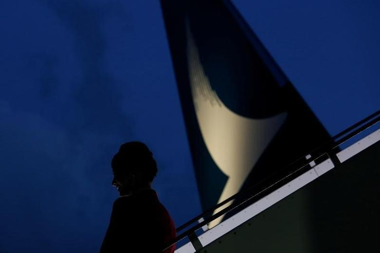 A flight attendant stands on the stairs to a new Cathay Pacific Airways Airbus A350 after being received by the airline at Hong Kong Airport May 30, 2016.   REUTERS/Bobby Yip
