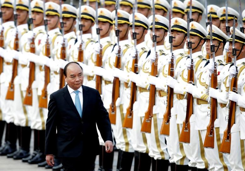 Vietnam's Prime Minister Nguyen Xuan Phuc reviews navy soldiers' honour guard during a welcoming ceremony at the Great Hall of the People in Beijing, China, September 12, 2016. REUTERS/Jason Lee
