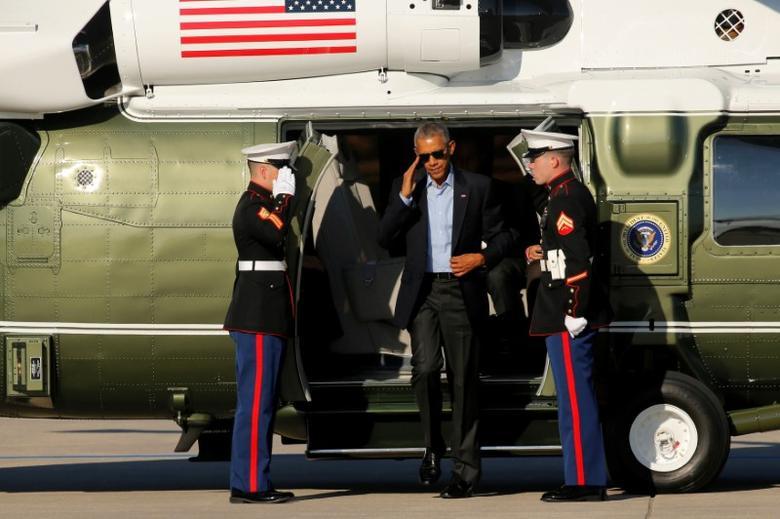 U.S. President Barack Obama arrives aboard the Marine One helicopter to depart O