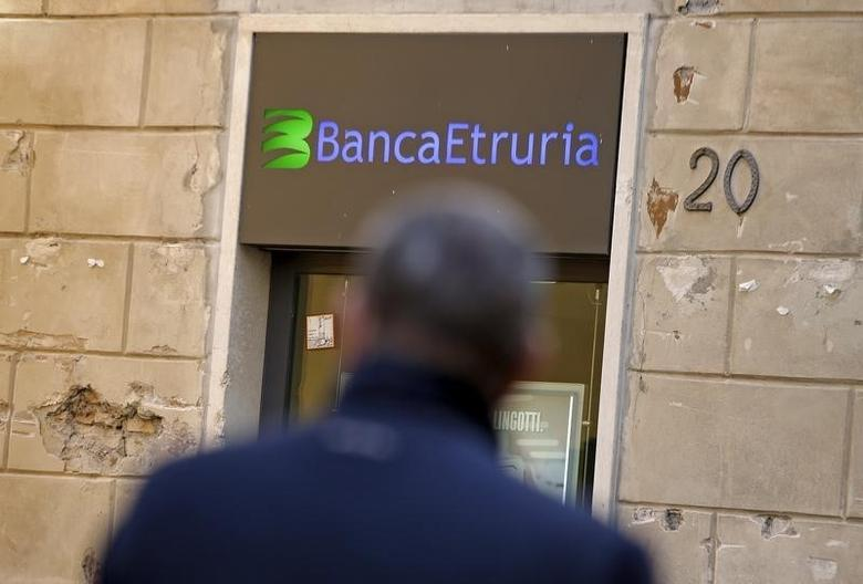 A man walks in front of Banca Etruria in downtown Rome, Italy, December 15, 2015.  REUTERS/Max Rossi