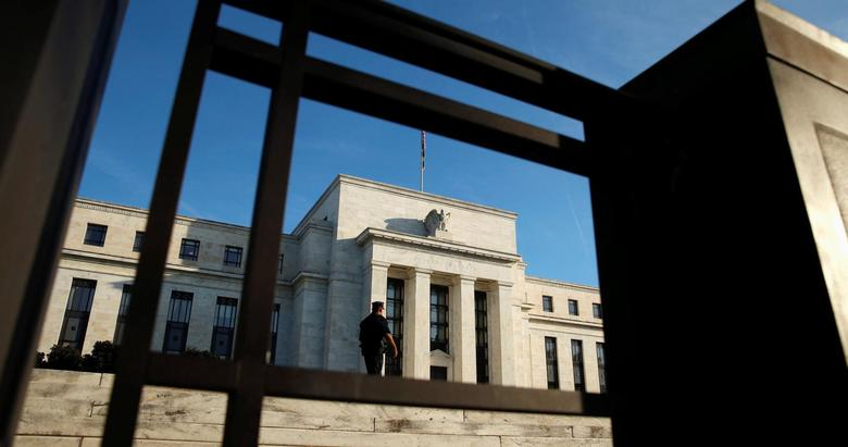 A police officer keeps watch in front of the U.S. Federal Reserve in Washington October 12, 2016. REUTERS/Kevin Lamarque