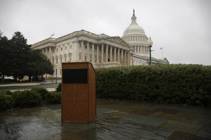 An empty speaker's lectern is seen in the rain outside the U.S. Capitol in Washington, October 10, 2013. REUTERS/Jonathan Ernst