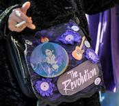 Prince memorabilia covers a fan's purse as thousands gather for an all-star concert paying tribute to Prince, six months after the influential pop star died, in St. Paul, Minnesota, U.S., October 13, 2016. REUTERS/Craig Lassig
