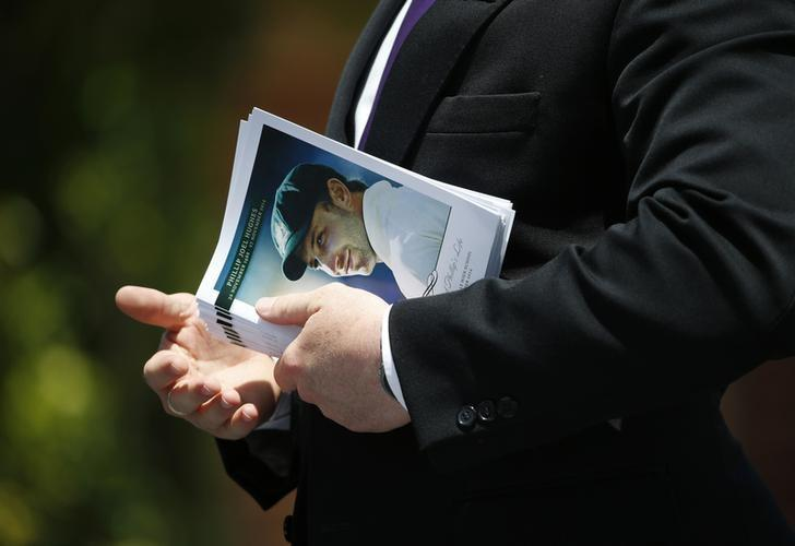 An order of service for the funeral of Australian cricketer Phillip Hughes is pictured prior to being distributed to mourners in his home town of Macksville, December 3, 2014. REUTERS/Jason Reed/Files