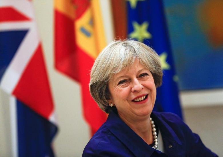 British Prime Minister Theresa May smiles during a meeting with Spain