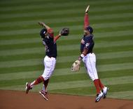 Oct 14, 2016; Cleveland, OH, USA; Cleveland Indians players Francisco Lindor (12) and Rajai Davis (20) celebrate after defeating the Toronto Blue Jays in game one of the 2016 ALCS playoff baseball series at Progressive Field. Mandatory Credit: David Richard-USA TODAY Sports