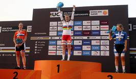 First-placed Amalie Dideriksen of Denmark (C), second-placed Kirsten Wild of the Netherlands (L) and third-placed Lotta Lepisto of Finland pose on the podium at the end of Women Elite Road Race in the UCI Road World Championships 2016, in Doha, Qatar October 15, 2016. REUTERS/Ibrahem Alomari