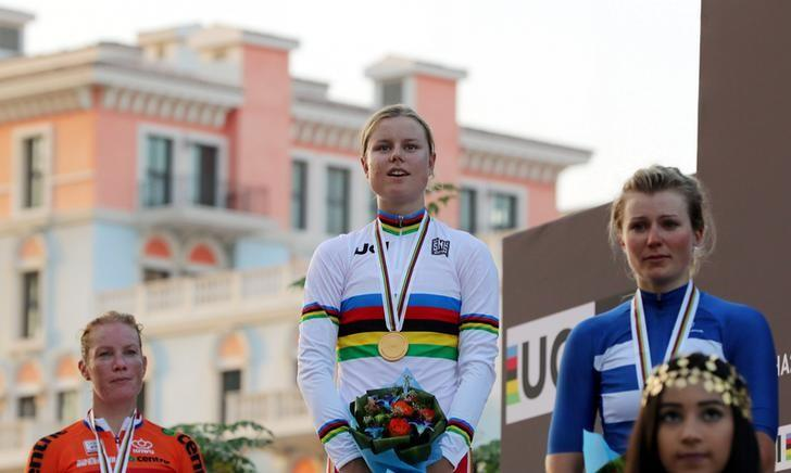 First-placed Amalie Dideriksen of Denmark (C), second-placed Kirsten Wild of the Netherlands (L) and third-placed Lotta Lepisto of Finland pose on the podium at the end of the Women Elite Road Race in the UCI Road World Championships 2016, in Doha, Qatar October 15, 2016. REUTERS/Ibrahem Alomari
