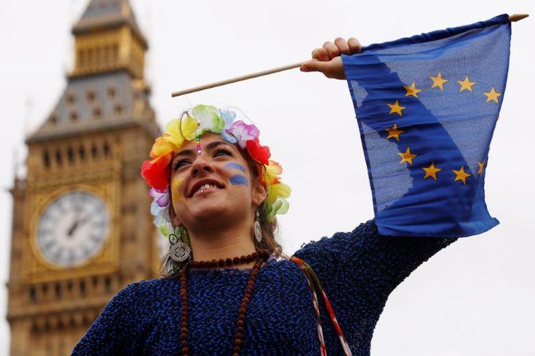 A Pro-Europe demonstrator waves a flag during a ''March for Europe'' protest against the Brexit vote result earlier in the year, in London, Britain, September 3, 2016.  REUTERS/Luke MacGregor
