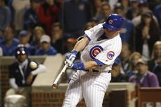Oct 15, 2016; Chicago, IL, USA; Chicago Cubs pinch hitter Miguel Montero (47) hits a grand slam against the Los Angeles Dodgers during the eighth inning of game one of the 2016 NLCS playoff baseball series at Wrigley Field. Mandatory Credit: Jon Durr-USA TODAY Sports